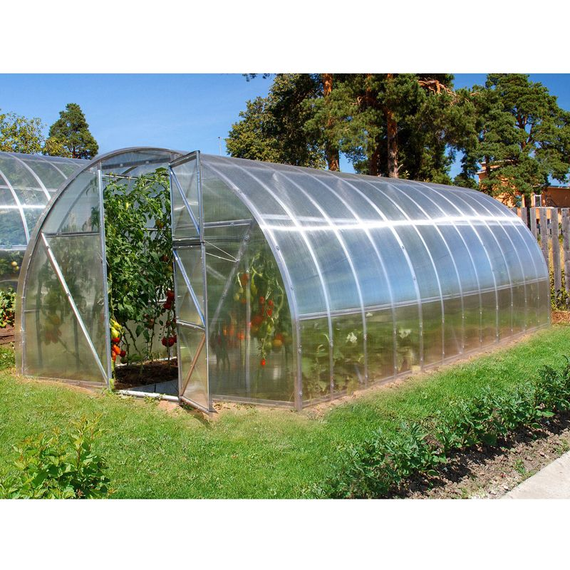 Теплица Воля Дачная-2ДУМ-8 (каркас+поликарбонат 4мм)Теплица под поликарбонат с покрытием Воля Дачная-ДУМ-8<br><br>Дачная теплица с покрытием из поликарбоната<br><br>НАЗНАЧЕНИЕ:<br><br>Теплица предназначена для создания особого микроклимата при<br><br>выращивании садовых растений и продления времени их плодоношения.<br><br>ПРЕИМУЩЕСТВА:<br><br>Каркас теплицы сделан из оцинкованной низкоуглеродной стали &amp;mdash; не<br><br>подвержен коррозии;<br><br>Длина теплицы - 8 метров &amp;mdash; позволяет одновременно выращивать несколько<br><br>овощных культур;<br><br>Для установки теплицы не требуется заливать фундамент, нужно лишь<br><br>углубить каркас в грунт;<br><br>Благодаря арочному строению снег легко скатывается с крыши;<br><br>Разобранную теплицу возможно транспортировать на легковом автомобиле;<br><br>В комплект входит все необходимое для установки &amp;mdash; и крепления, и<br><br>иллюстрированная инструкция;<br><br>Возможно наращивать длину теплицы при необходимости;<br><br>Шаг дуги 0,5м, поэтому каркас теплицы выдерживает нагрузку снежного<br><br>покрова до 90 кг/м2 и не проседает;<br><br>При необходимости конструкцию можно усилить дополнительными<br><br>профилями, которые приобретаются отдельно;<br><br>При помощи торцевых дверей и форточек с обеих сторон легко можно<br><br>создать нужный температурный режим;<br><br>Покрытие из поликарбоната прочное и прозрачное (пропускает около 90%<br><br>естественного освещения);<br><br>Теплицу можно переставить с одного места на другое &amp;mdash; вес одной секции 40-<br><br>50кг.<br><br>РЕКОМЕНДАЦИИ:<br><br>Располагайте каркас на плоской и ровной поверхности;<br><br>Производите техническое обслуживание теплицы в зимний период;<br><br>При монтаже теплицы избегайте провисаний профилей, они могут погнуться,<br><br>используйте подставки или стулья;<br><br>При сборке осуществляйте крепление по всем отверстиям, это сделает<br><br>конструкцию максимально прочной;<br><br>Предварительную сборку производите без затягивания винтовых 